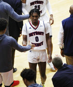 Detroit Mercy guard Antoine Davis walks to the bench after breaking Steph Curry's NCAA record for 3-point baskets by a freshman, during the second half of the team's NCAA college basketball game against IUPUI, Thursday, Feb. 28, 2019, in Detroit. (AP Photo/Carlos Osorio)