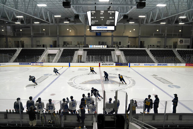 FILE - In this Jan. 5, Members of the St. Louis Blues practice during NHL hockey training camp in Maryland Heights, Mo. The Blues announced Monday, Jan. 11, 2021, that 300 fans will be allowed in for the home opener on Jan. 18 against San Jose. The Blues said all of the fans allowed in will be frontline workers in health care or public safety fields. (AP Photo/Jeff Roberson File)