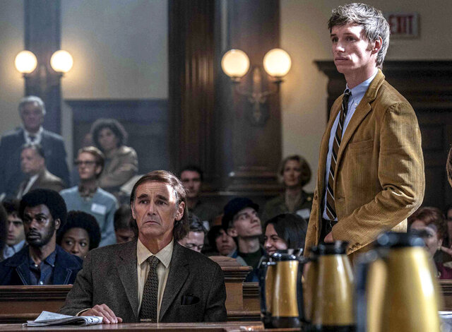 This image released by Netflix shows Mark Rylance, left, and Eddie Redmayne in a scene from