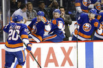New York Islanders' Kieffer Bellows (20) celebrates with teammates after scoring a goal during the second period of the team's NHL hockey game against the Los Angeles Kings on Thursday, Feb. 6, 2020, in New York. (AP Photo/Frank Franklin II)