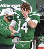 New York Jets quarterback Sam Darnold (14) puts on a cap after he threw an interception, his second of the game, in the fourth quarter against the Miami Dolphins on Sunday, Nov. 29, 2020, in East Rutherford, N.J. (Andrew Mills/NJ Advance Media via AP)