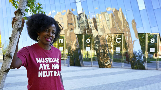 La Tanya Autry, a curatorial fellow at The Museum of Contemporary Art Cleveland, poses outside of the museum in Cleveland on Thursday, Oct. 8, 2020. Museums are being called on to examine what's on their walls amid a national reckoning on racism. Among 18 major U.S. museums, 85% of artists featured are white, while 87% are men, according to a 2019 study conducted at Williams College. Autry helped start an initiative called Museums Are Not Neutral. (AP Photo/Tony Dejak)