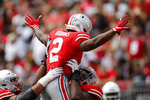 Ohio State running back J.K. Dobbins celebrates his touchdown against Cincinnati during the first half of an NCAA college football game Saturday, Sept. 7, 2019, in Columbus, Ohio. (AP Photo/Jay LaPrete)