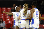 UCLA forward Michaela Onyenwere, left, celebrates with teammates Lindsey Corsaro and Lauryn Miller after Corsaro scored and Tennessee called a timeout in the first half of first-round game in the NCAA women's college basketball tournament, Saturday, March 23, 2019, in College Park, Md. UCLA won 89-77. (AP Photo/Patrick Semansky)