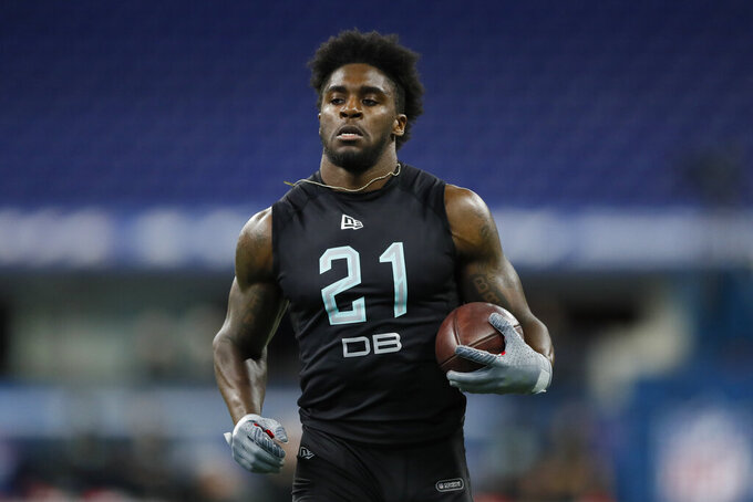 FILE - In this March 1, 2020, file photo, Utah defensive back Jaylon Johnson runs a drill at the NFL football scouting combine in Indianapolis.Johnson was selected by the Chicago Bears in the second round of the NFL football draft Friday, April 24, 2020. (AP Photo/Charlie Neibergall, File)