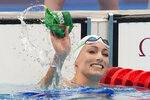 Tatjana Schoenmaker, of South Africa, reacts after winning a semifinal in the women's 100-meter breaststroke at the 2020 Summer Olympics, Monday, July 26, 2021, in Tokyo, Japan. (AP Photo/Petr David Josek)