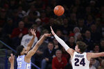 North Carolina guard Jeremiah Francis (13) shoots over Gonzaga forward Corey Kispert (24) during the first half of an NCAA college basketball game in Spokane, Wash., Wednesday, Dec. 18, 2019. (AP Photo/Young Kwak)