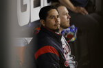FILE - In this May 30, 2019, file photo, Cleveland Indians starting pitcher Carlos Carrasco looks to the field from the dugout during the seventh inning of a baseball game against the Chicago White Sox, in Chicago. The Indians made one stirring comeback after another through a season littered with adversity, misfortune and unexpected challenges. Their last one fell short. For the first time since 2015, baseball's postseason will go on without them. (AP Photo/Nam Y. Huh, File)