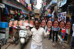 A man wears cut-outs of U.S.President-elect Joe Biden and Vice President-elect Kamala Harris and walks on a street in Chennai, India, Wednesday, Jan. 20, 2021. The inauguration of Biden and Harris is scheduled be held Wednesday. (AP Photo/R. Parthibhan)