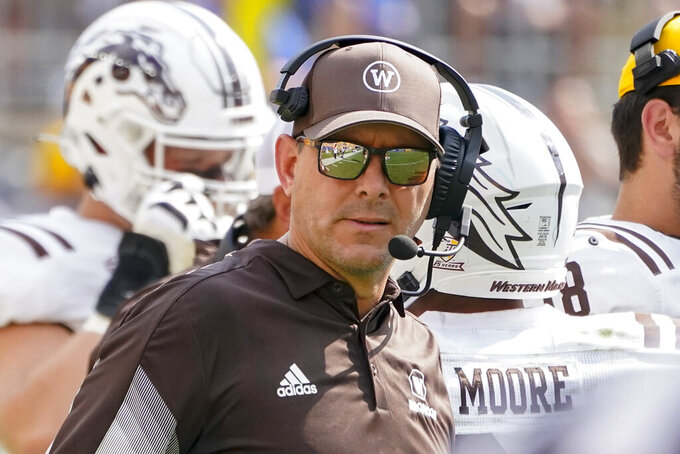 Western Michigan head coach Tim Lester watches as his team plays against Pittsburgh during the second half of an NCAA college football game, Saturday, Sept. 18, 2021, in Pittsburgh. Western Michigan won 44-41.(AP Photo/Keith Srakocic)