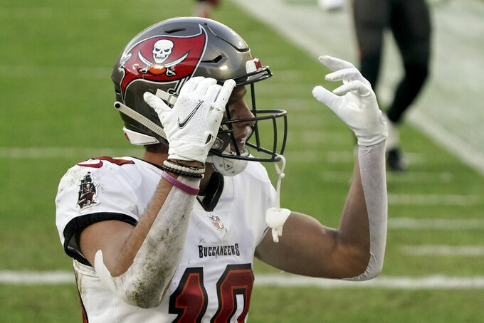 Tampa Bay Buccaneers' Scott Miller reacts after catching a 39-yard touchdown pass against Green Bay Packers' Kevin King during the first half of the NFC championship NFL football game in Green Bay, Wis., Sunday, Jan. 24, 2021. (AP Photo/Morry Gash)