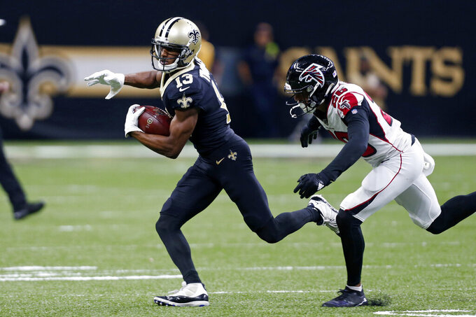 New Orleans Saints wide receiver Michael Thomas (13) carries past Atlanta Falcons cornerback Isaiah Oliver (26) on a pass play in the second half of an NFL football game in New Orleans, Sunday, Nov. 10, 2019. (AP Photo/Butch Dill)