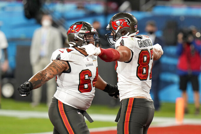 Tampa Bay Buccaneers tight end Rob Gronkowski, right, celebrates with teammate Aaron Stinnie after catching a 17-yard touchdown pass during the first half of the NFL Super Bowl 55 football game against the Kansas City Chiefs Sunday, Feb. 7, 2021, in Tampa, Fla. (AP Photo/Chris O'Meara)