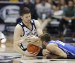 Butler's Nate Fowler (51) and Creighton's Mitch Ballock (24) battle for a loose ball during the first half of an NCAA college basketball game, Saturday, Jan. 5, 2019, in Indianapolis. (AP Photo/Darron Cummings)