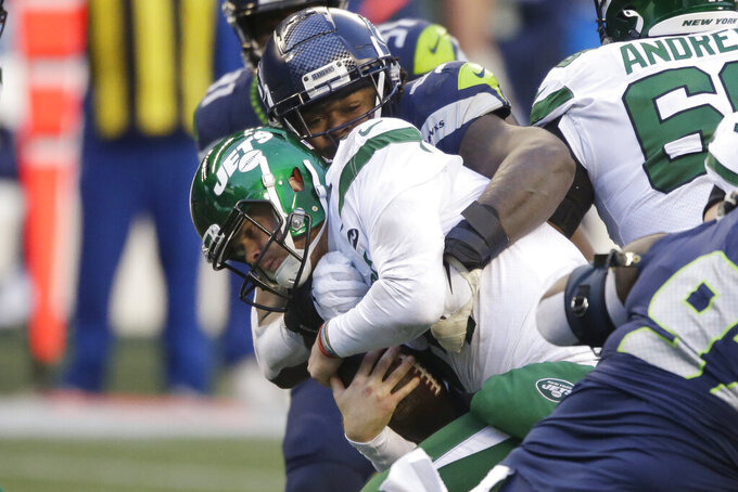 New York Jets quarterback Sam Darnold is sacked against the Seattle Seahawks during the second half of an NFL football game, Sunday, Dec. 13, 2020, in Seattle. (AP Photo/Lindsey Wasson)