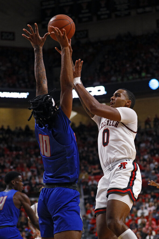 Texas Tech's Kyler Edwards (0) shoots the ball over Tennessee State's Shakem Johnson (10) during the first half of an NCAA college basketball game Thursday, Nov. 21, 2019, in Lubbock, Texas. (AP Photo/Brad Tollefson)