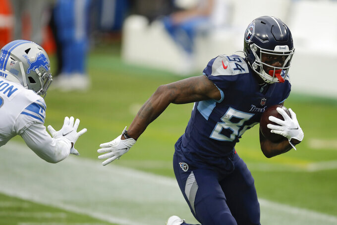 Tennessee Titans wide receiver Corey Davis runs for a touchdown during the first half of an NFL football game against the Detroit Lions Sunday, Dec. 20, 2020, in Nashville, Tenn. (AP Photo/Ben Margot)