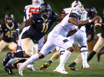 Campbell quarterback Hajj-Malik Williams scrambles under pressure from Wake Forest defensive lineman Miles Fox (11) during an NCAA college football game Friday, Oct. 2, 2020, in Winston-Salem, N.C. (Andrew Dye/The Winston-Salem Journal via AP)