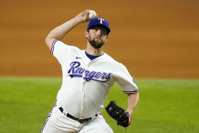 Texas Rangers starting pitcher Jordan Lyles throws during the fifth inning of the team's baseball game against the Houston Astros in Arlington, Texas, Tuesday, Sept. 14, 2021. (AP Photo/Tony Gutierrez)