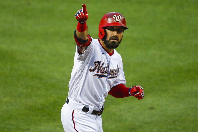 Washington Nationals Adam Eaton celebrates his solo homer against the New York Yankees during the first inning of an opening day baseball game at Nationals Park, Thursday, July 23, 2020, in Washington. (AP Photo/Alex Brandon)