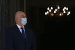 Greek Foreign Minister Nikos Dendias wearing mask waits for the arrival of al his Italian counterpart Luigi Di Maio at the Foreign Ministry in Athens, on Tuesday, June 9, 2020. (Costas Baltas /Pool via AP)