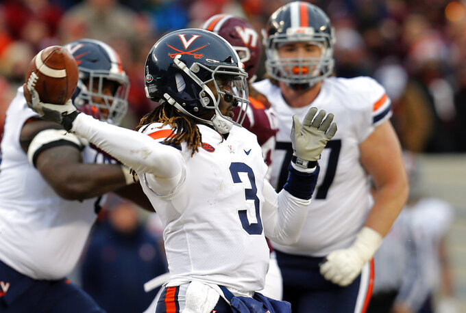 Virginia quarterback Bryce Perkins (3) tosses a pass during the first half of an NCAA college football game against Virginia Tech in Blacksburg, Va., Friday, Nov. 23, 2018. (AP Photo/Steve Helber)