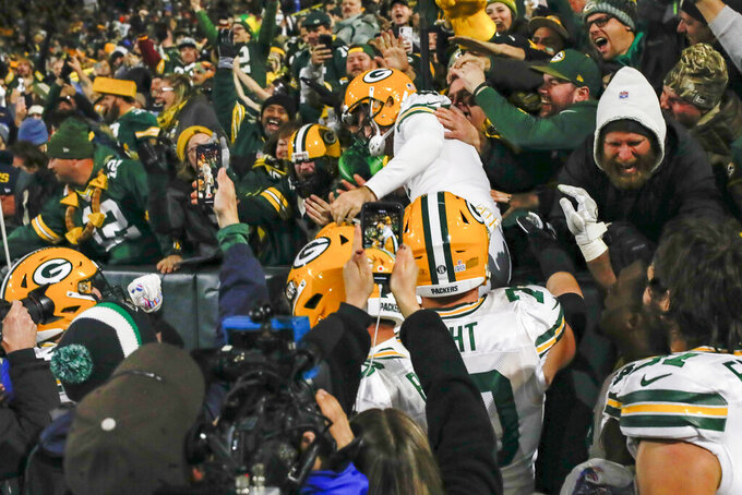 Green Bay Packers kicker Mason Crosby celebrates kicking the game-winning field goal by jumping in the stands following an NFL football game against the Detroit Lions, Monday, Oct. 14, 2019, in Green Bay, Wis. Green Bay won 23-22. (AP Photo/Jeffrey Phelps)