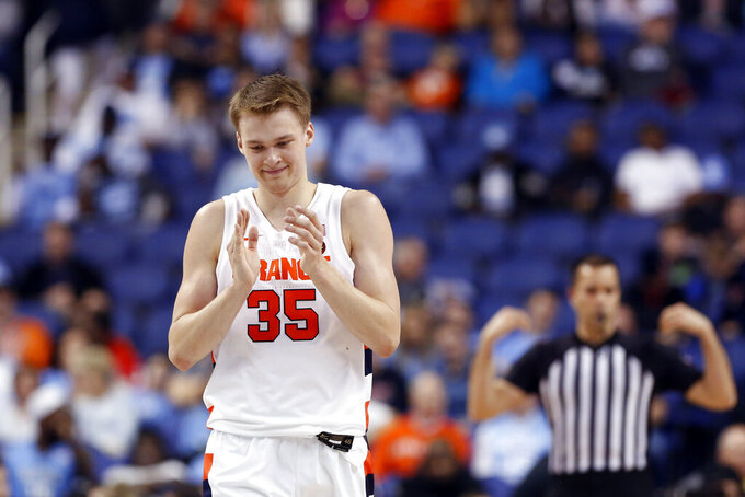 Syracuse guard Buddy Boeheim (35) reacts following a play against North Carolina during the second half of an NCAA college basketball game at the Atlantic Coast Conference tournament in Greensboro, N.C., Wednesday, March 11, 2020. (AP Photo/Ben McKeown)