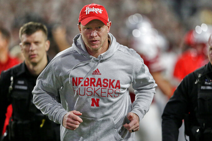 In this Sept. 28, 2019, photo, Nebraska head coach Scott Frost runs to the locker room following a 48-7 loss to Ohio State in an NCAA college football game in Lincoln, Neb. The Cornhuskers have underachieved in a season in which they were a popular pick to win the Big Ten West. They are 4-4 and well behind Minnesota in the West race. Tension is palpable inside and outside the program. (AP Photo/Nati Harnik)
