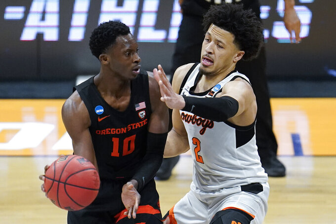 Oklahoma State guard Cade Cunningham (2) applies pressure to Oregon State forward Warith Alatishe (10) during the second half of a men's college basketball game in the second round of the NCAA tournament at Hinkle Fieldhouse in Indianapolis, Sunday, March 21, 2021. (AP Photo/Paul Sancya)