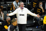 Iowa head coach Fran McCaffery questions a call against his team during the first half of an NCAA college basketball game against Wisconsin, Sunday, March 7, 2021, in Iowa City, Iowa. (AP Photo/Charlie Neibergall)