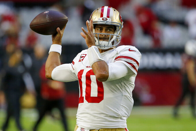 San Francisco 49ers quarterback Jimmy Garoppolo (10) warms up prior to an NFL football game against the Arizona Cardinals, Thursday, Oct. 31, 2019, in Glendale, Ariz. (AP Photo/Rick Scuteri)