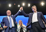 Markus Soeder, right, CSU party leader and prime minister of Bavaria, and Armin Laschet, CDU/CSU candidate for chancellor, stand together on stage after Laschet's speech at the CSU party conference in Nuremberg, Germany, Saturday, Sept.11, 2021. (Peter Kneffel/dpa via AP)