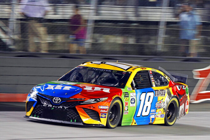 Kyle Busch goes down the back straight during the NASCAR Cup Series auto race Saturday, Aug. 17, 2019, in Bristol, Tenn. (AP Photo/Wade Payne)