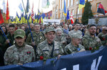 Ukrainian army veterans attend a rally marking Defense of the Homeland Day in center Kyiv, Ukraine, Monday, Oct. 14, 2019. Some 15,000 far-right and nationalist activists protested in the Ukrainian capital, chanting