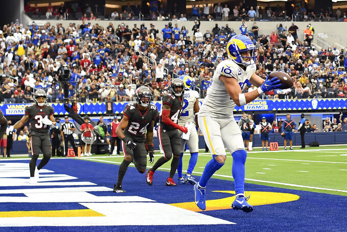 Los Angeles Rams wide receiver Cooper Kupp (10) catches a touchdown during the first half of an NFL football game against the Tampa Bay Buccaneers Sunday, Sept. 26, 2021, in Inglewood, Calif. (AP Photo/Kevork Djansezian)