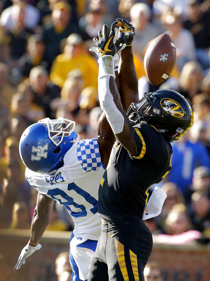 Missouri defensive back DeMarkus Acy (2) breaks up a pass intended for Kentucky wide receiver Isaiah Epps (81) during the first half of an NCAA college football game Saturday, Oct. 27, 2018, in Columbia, Mo. (AP Photo/Charlie Riedel)