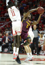 Minnesota guard Marcus Carr (5) manages a shot as Utah's Both Gach defends during an NCAA college basketball game Friday, Nov. 15, 2019, in Salt Lake City. (Francisco Kjolseth/The Salt Lake Tribune via AP)