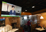 TV telecast shows that Hong Kong Chief Executive Carrie Lam makes an announcement on the extradition bill, at a restaurant in Hong Kong, on Wednesday, Sept. 4, 2019. Hong Kong Chief Executive Lam has announced the government will formally withdraw an extradition bill that has sparked months of demonstrations in the city, bowing to one of the protesters' demands. The bill would have allowed Hong Kong residents to be sent to mainland China for trials. It sparked massive protests that have become increasingly violent and caused the airport to shut down earlier this month.(AP Photo/Vincent Yu)