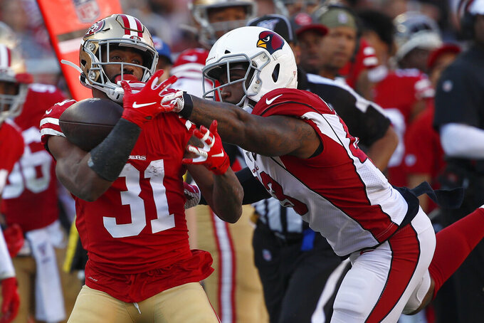 San Francisco 49ers running back Raheem Mostert (31) cannot catch a pass while defended by Arizona Cardinals outside linebacker Haason Reddick during the first half of an NFL football game in Santa Clara, Calif., Sunday, Nov. 17, 2019. (AP Photo/Josie Lepe)
