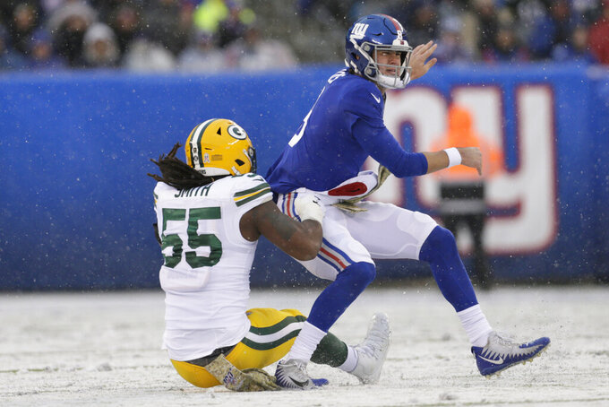 Green Bay Packers' Za'Darius Smith, left, takes down New York Giants quarterback Daniel Jones as he throws during the first half of an NFL football game, Sunday, Dec. 1, 2019, in East Rutherford, N.J. (AP Photo/Adam Hunger)