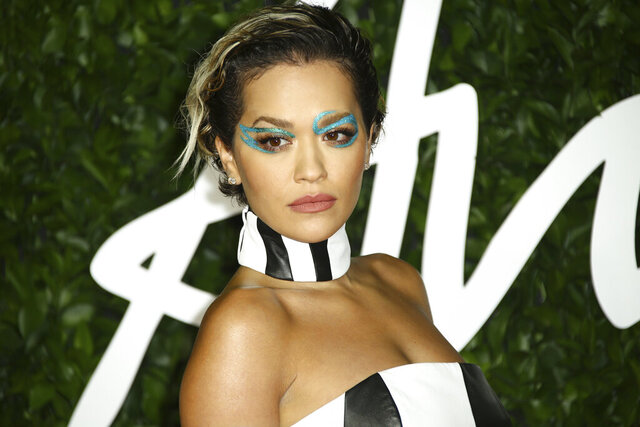 "FILE - In this Monday, Dec. 2, 2019 file photo, singer Rita Ora poses for photographers upon her arrival at the British Fashion Awards in central London. British singer Rita Ora apologized Monday Nov. 30, 2020, for breaking lockdown rules by holding a birthday party, saying it was ""a serious and inexcusable error of judgment."" (Photo by Joel C Ryan/Invision/AP, File)"
