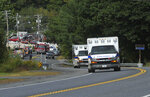 Ambulances travel, Monday, Sept. 16, 2019, from the scene of a propane explosion which leveled new construction in Farmington, Maine. (Rich Abrahamson/The Central Maine Morning Sentinel via AP)