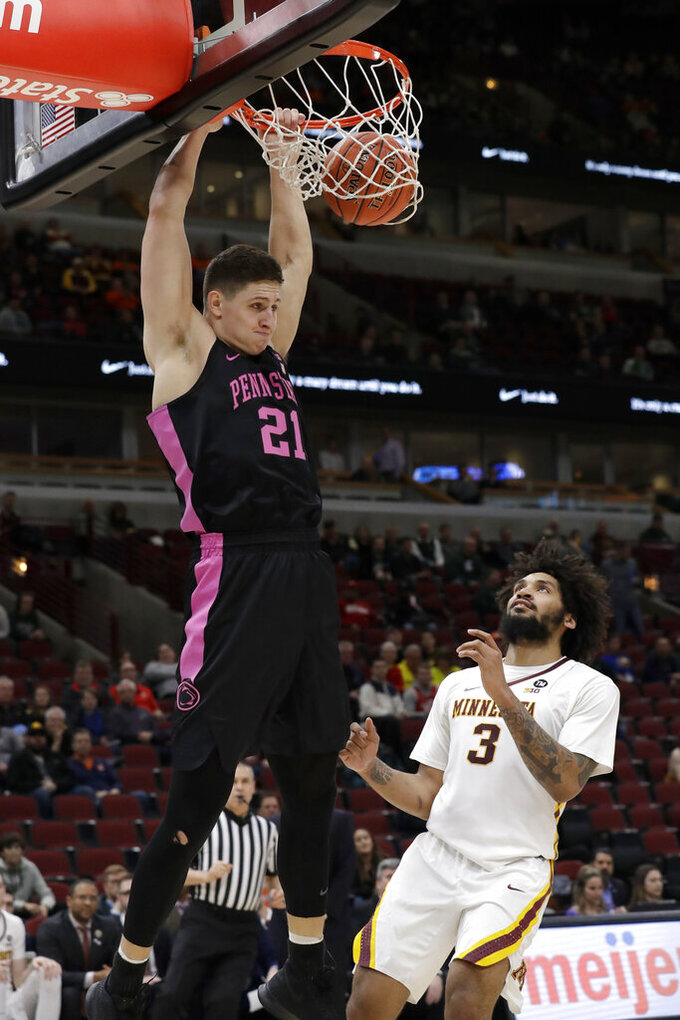 Penn State's John Harrar (21) dunks over Minnesota's Jordan Murphy (3) during the first half of an NCAA college basketball game in the second round of the Big Ten Conference tournament, Thursday, March 14, 2019, in Chicago. (AP Photo/Nam Y. Huh)