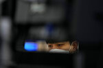 A currency trader watches computer monitors at the foreign exchange dealing room in Seoul, South Korea, Friday, Sept. 10, 2021. Shares were higher in Asia on Friday as investors stepped up buying despite another decline on Wall Street that kept the S&P 500 and the Nasdaq on track for their first weekly losses in three weeks. (AP Photo/Lee Jin-man)