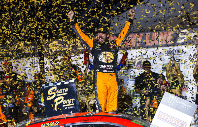 Martin Truex Jr. celebrates after winning a NASCAR Cup Series auto race at the Las Vegas Motor Speedway on Sunday, Sept. 15, 2019. (AP Photo/Chase Stevens)