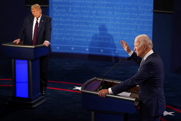 President Donald Trump listens to Democratic presidential candidate former Vice President Joe Biden during the first presidential debate Tuesday, Sept. 29, 2020, at Case Western University and Cleveland Clinic, in Cleveland, Ohio. (AP Photo/Morry Gash, Pool)