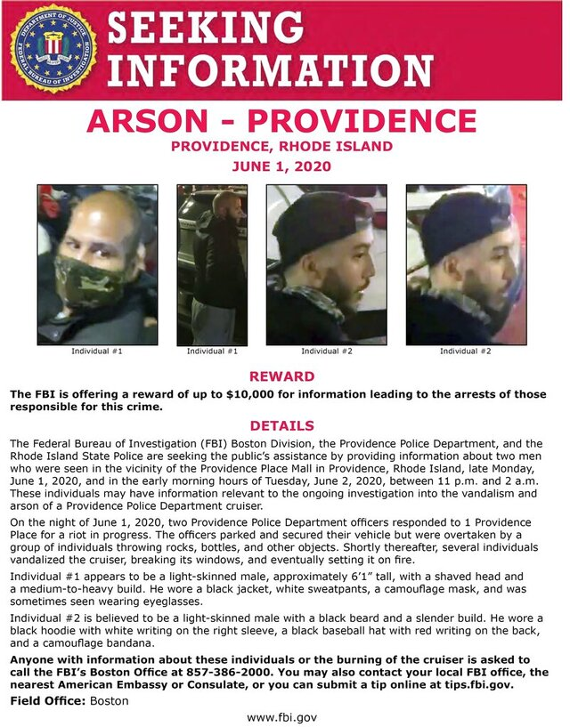 This image released Thursday, Aug. 6, 2020, by the Federal Bureau of Investigation shows an FBI poster seeking two men who may have information relevant to the investigation of vandalism and arson of a Providence Police Department cruiser late Tuesday, June 1, in Providence, R.I. The cruiser was pelted with objects then burned near the Providence Place Mall after a protest turned chaotic. (FBI via AP)