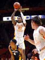 Tennessee guard Jordan Bowden (23) shoots over Chattanooga guard Maurice Commander (4) during the first half of an NCAA college basketball game Monday, Nov. 25, 2019, in Knoxville, Tenn. (AP Photo/Wade Payne)
