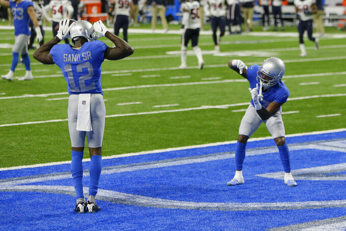 Detroit Lions wide receiver Mohamed Sanu (12) celebrates his touchdown with wide receiver Marvin Jones during the second half of an NFL football game against the Houston Texans, Thursday, Nov. 26, 2020, in Detroit. (AP Photo/Duane Burleson)